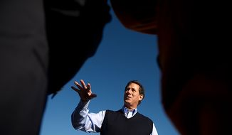 "Republican presidential candidate Rick Santorum speaks with a reporter before starting a town hall meeting at the Button Factory Restaurant to discuss ""faith, family, and freedom"", Muscatine, IA, Thursday, December 29, 2011. (Andrew Harnik / The Washington Times)"