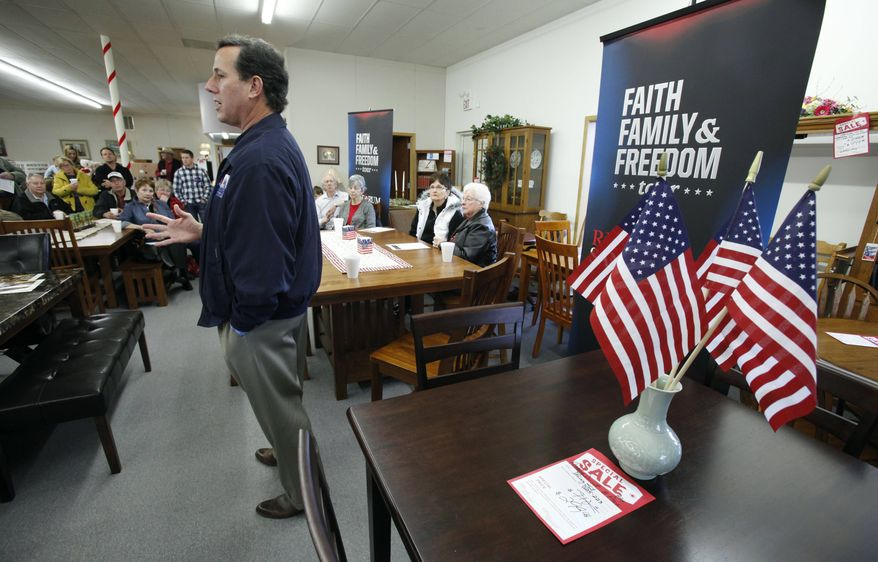 Republican presidential candidate and former Pennsylvania Sen. Rick Santorum speaks Dec. 28, 2011, to local residents during a campaign stop at USA Furniture and Bedding in Dubuque, Iowa. (Associated Press)