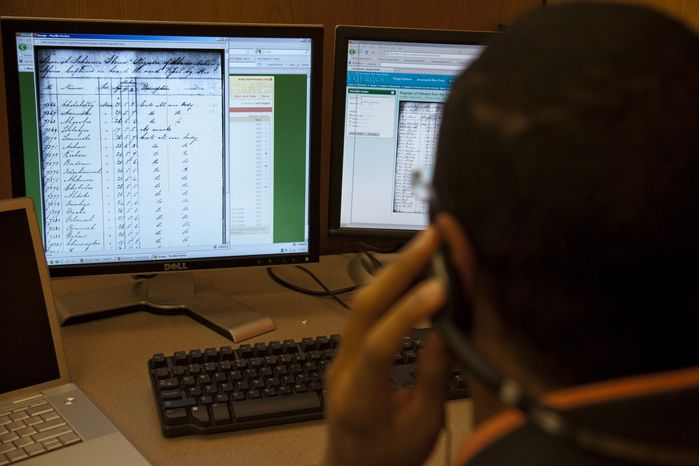 Nafees Khan, project manager for African-Origins at Emory University in Atlanta, listens March 2010 to the audio recordings of names found in Courts of Mixed Commission records for Havana and Freetown, Sierra Leone, to identify their likely ethno-linguistic origins. (Associated Press/Emory University)