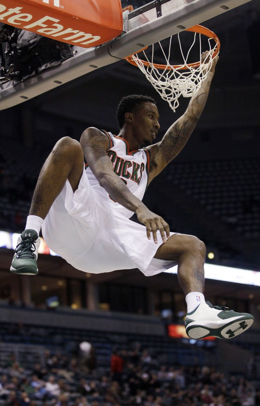 Milwaukee Bucks' Brandon Jennings is averaging 23 points, 5.5 assists and 3.0 rebounds per game in two games this season. (AP Photo/Morry Gash)