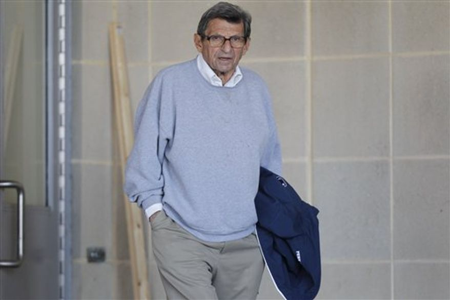 Penn State coach Joe Paterno leaves the Louis and Mildred Lasch Football Building on campus Tuesday, Nov. 8, 2011, in State College, Pa. (AP Photo/Matt Rourke)