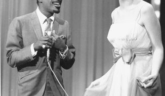 """**FILE** Kaye Stevens (left) performs Jan. 6, 1967, with Sammy Davis Jr., on a TV show. Stevens, a singer, actress and longtime South Florida resident who was a frequent guest on Johnny Carson's """"The Tonight Show,"""" has died at a central Florida hospital. She was 79. (Associated Press)"""