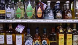 Bottles of alcohol are seen lining the shelves of a liquor store Aug. 31, 2009, in Springfield, Ill. (Associated Press)
