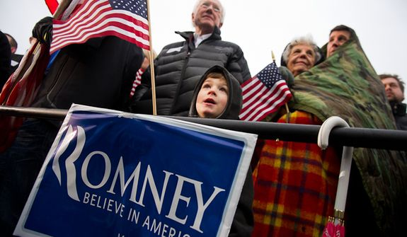 Left to right: Bill Koenig of West Des Moines with his 5 year old grandson Graham Kenworthy braves the cold and rain alongside Marcella Yochum and her son Scott Yochum to see Republican presidential candidate Mitt Romney speak at an early morning rally at a Hy-Vee grocery store, West Des Moines, IA, Friday, December 30, 2011. (Andrew Harnik / The Washington Times)