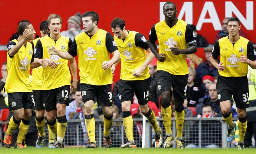 Blackburn Rovers' Grant Hanley, third left, is congratulated by teammates after scoring the winning goal during the English Premier League soccer match against Manchester United at Old Trafford Stadium, Manchester, England, Saturday Dec. 31, 2011. Blackburn won 3-2. (AP Photo/Jon Super)
