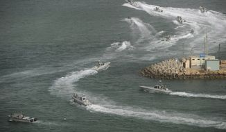 ** FILE ** Iranian navy speed boats attend a drill in the Sea of Oman on Friday, Dec. 30, 2011. Iran's navy chief has reiterated for a second time in less than a week that his country can easily close the strategic Strait of Hormuz at the mouth of the Persian Gulf, the passageway through which a sixth of the world's oil flows. (AP Photo/IIPA, Ali Mohammadi)