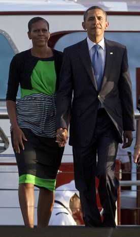 President Obama and first lady Michelle Obama arrive Dec. 29, 2011, at the USS Arizona Memorial at Pearl Harbor in Honolulu, Hawaii, part of the World War II Valor in the Pacific National Monument. (Associated Press)