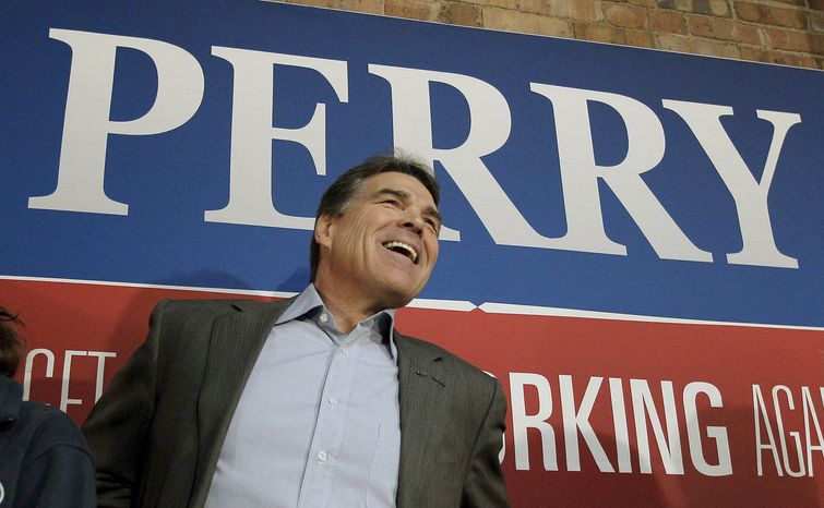 ** FILE ** Texas Gov. Rick Perry looks at the crowd as he is introduced during a stop on his GOP presidential campaign in Fort Dodge, Iowa, on Saturday, Dec. 31, 2011. (AP Photo/Charlie Riedel)