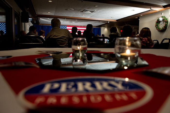 Supporters listen as Republican presidential candidate Rick Perry speaks at a fundraiser held at the Mason City Country Club, Mason City, Iowa, Friday, Dec. 30, 2011. (Andrew Harnik/The Wa