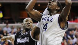 Georgetown center Henry Sims, right, goes to the basket against Providence forward Kadeem Batts (10) during the second half, Saturday, Dec. 31, 2011, in Washington. Georgetown won 49-40. (AP Photo/Nick Wass)