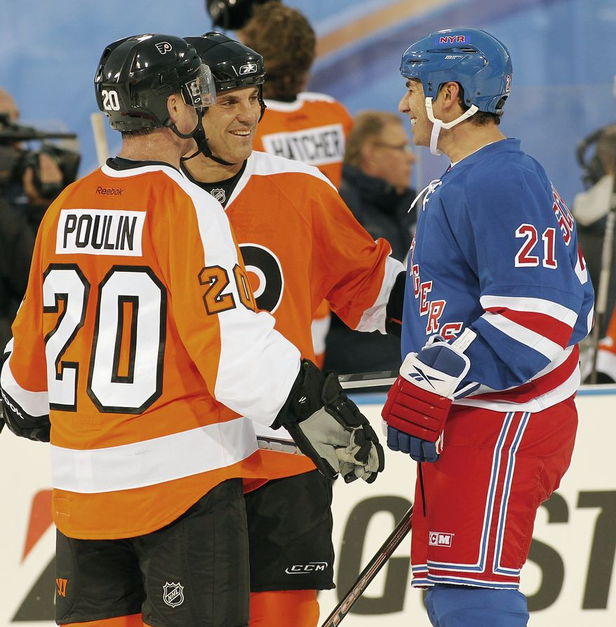 Dave Poulin, left, and Rick Tocchet, center, of the Philadelphia Flyers alumni team, talk with Mathieu Schnieder, right, of the New York Rangers alumni team, during the second period of the Winter Classic Alumni NHL hockey game on Saturday, Dec. 31, 2011, in Philadelphia. (AP Photo/Tom Mihalek)