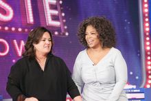 """Oprah Winfrey is shown with host Rosie O'Donnell (left) during the debut of """"The Rosie Show,"""" in Chicago in October. Miss Winfrey is tasked with rescuing OWN, the Oprah Winfrey Network, after a disappointing first year. """"The Rosie Show"""" was added to the network's lineup. (Harpo Inc. via Associated Press)"""