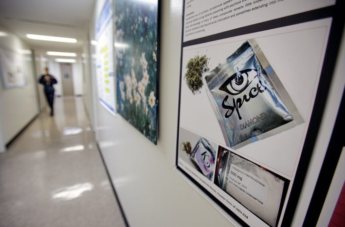 """A poster warns of the effects of the drug known as 'Spice' at the Naval Hospital in San Diego. The Navy has investigated more than 700 sailors and Marines this year for smoking the """"synthetic"""" marijuana.  (Associated Press)"""