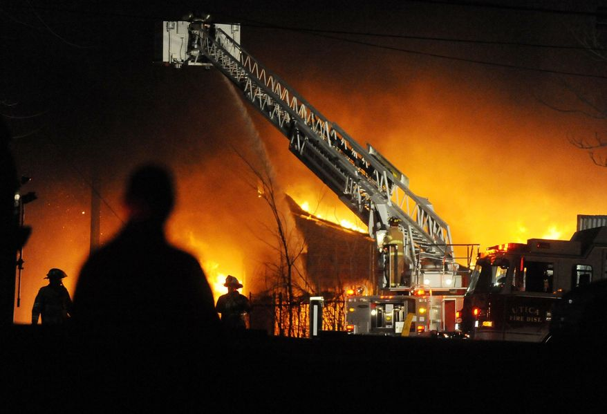 A fire destroys the former Westclox Co. clock factory in Peru, Ill. The building, which the National Park Service in 2007 deemed eligible for the National Register of Historic Places, caved in on itself Sunday morning. (Associated Press)
