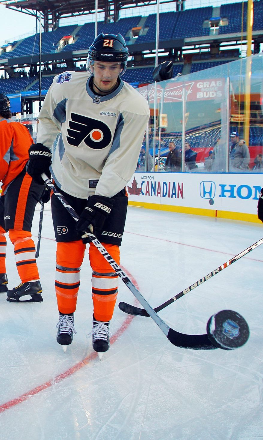Philadelphia Flyers forward James van Riemsdyk lofts the puck with his stick during practice for the Winter Classic. The 22-year-old Van Riemsdyk has nine goals and 19 assists in 31 games. (Associated Press)