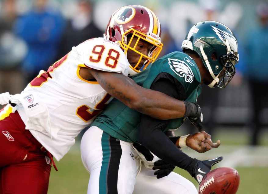 Redskins linebacker Brian Orakpo suffered a pectoral muscle injury while sacking Eagles quarterback Michael Vick during the second quarter. (Associated Press)