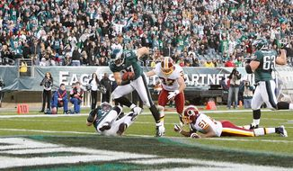 Eagles tight end Brent Celek leaves Redskins defenders Reed Doughty (37) and Keyaron Fox (51) in his wake while scoring on a 4-yard pass in Philadelphia's 34-10 win. (Associated Press)