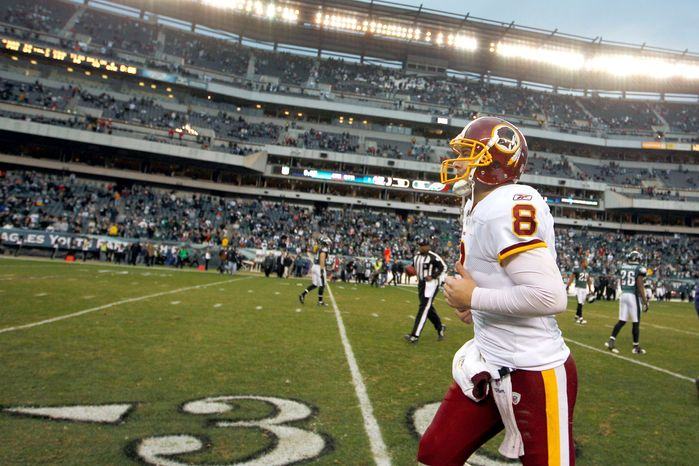 Washington Redskins' quarterback Rex Grossman threw an interception in the 34-10 loss to the Philadelphia Eagles on Sunday. His 25 interceptions for the season led the league. Sunday's loss gave the team a 5-11 record.