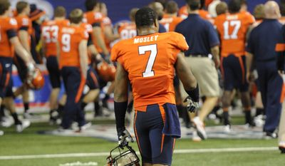 Virginia safety Corey Mosley (7) leaves the field after losing to Auburn in the Chick-fil-A Bowl on Saturday, Dec. 31, 2011, in Atlanta. Auburn won 43-24. (AP Photo/John Amis)