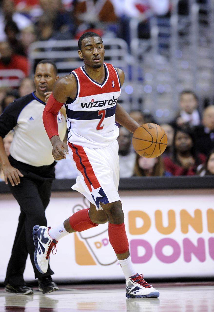 Washington Wizards guard John Wall is averaging 13 points, six assists and just under four rebounds this season. (AP Photo/Nick Wass)