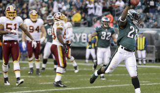 Philadelphia Eagles' Dion Lewis celebrates after scoring a touchdown during the second half of an NFL football game against the Washington Redskins, Sunday, Jan. 1, 2012, in Philadelphia. Philadelphia won 34-10. (AP Photo/Matt Slocum)