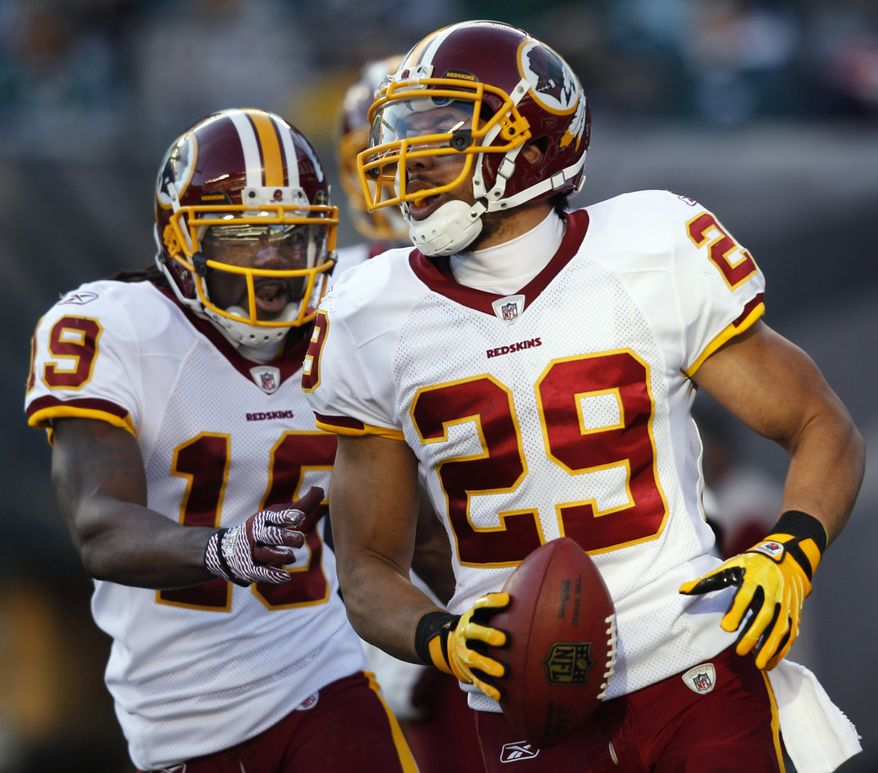 Washington Redskins' Donte' Stallworth (19) and Roy Helu (29) celebrate after Helu's touchdown during the second half against the Philadelphia Eagles, Sunday, Jan. 1, 2012, in Philadelphia. (AP Photo/Mel Evans)