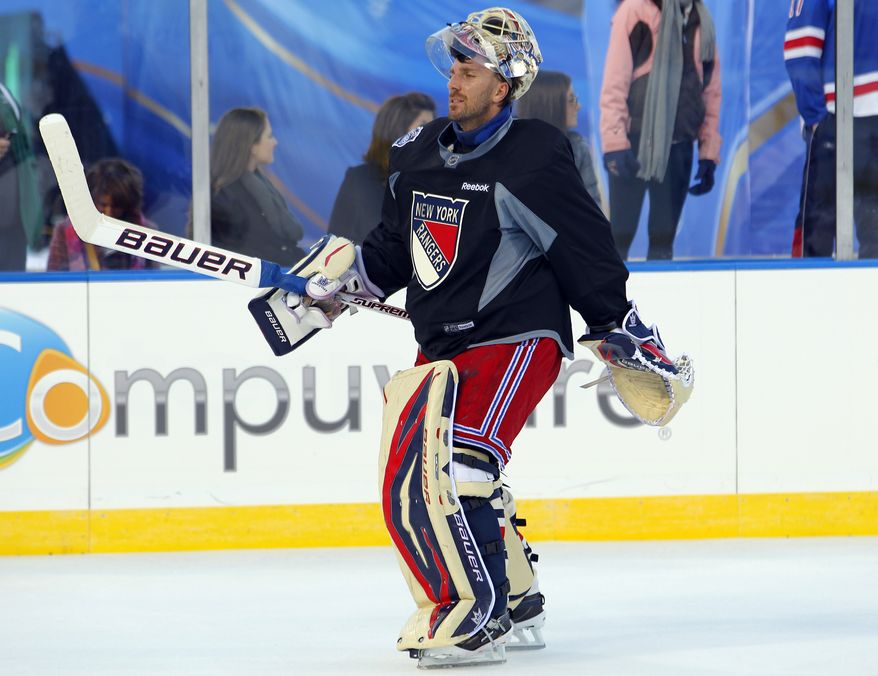 New York Rangers' goalie Henrik Lundqvist skates during practice for the Winter Classic against the Philadelphia Flyers, Sunday, Jan. 1, 2012, in Philadelphia. Lundqvist has a 16-7-4 record, 1.91 goals-agaisnt average and .937 save percentage this season. (AP Photo/Tom Mihalek)