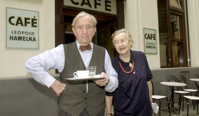 Leopold Hawelka and his late wife, Josefine, are seen at their Cafe Hawelka in Vienna in 2001, when he was 90 and she was 85. Mr. Hawelka, 100, died Thursday, but the cafe he opened more than 70 years ago remains a city icon. (Associated Press)