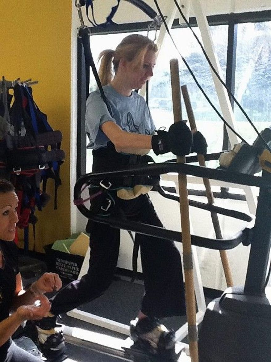 Rachelle Friedman Chapman, a North Carolina woman left paralyzed by a poolside accident, has grown stronger while training at a spinal cord injury recovery center in Carlsbad, Calif. (Associated Press)