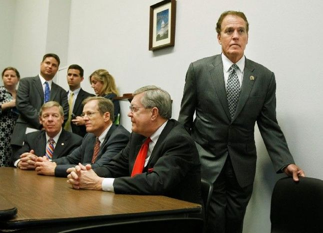 """""""When the rules are subjective and continue to change, we cannot expect these business owners to comply with moving target regulations. These inconsistent rulings from the bureau are confusing and result in a waste of time and resources,"""" said Rep. Phil Gingrey (right), Georgia Republican. (Associated Press)"""