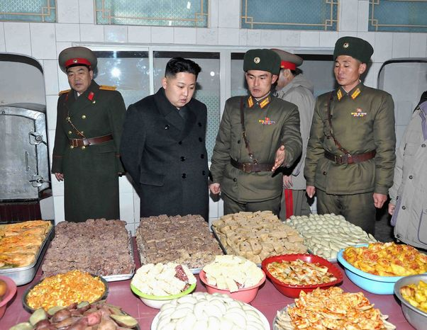 """People will be analyzing public appearances, rosters, who was standing next to whom, who was suddenly absent, who suddenly disappears,"" says Andrei Lankov, a North Korea specialist at Seoul's Kookmin University of the world's interest in the North's new leader, Kim Jong-un, seen inspecting the New Year's Day spread at a military post. (Korean Central News Agency via Associated Press)"