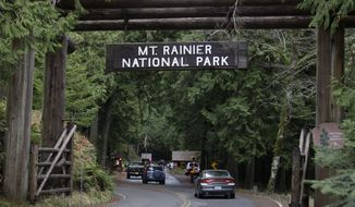 The west entrance to Mount Rainier National Park in Washington state is seen on Jan. 1, 2012. State patrol troopers were checking outgoing cars and park rangers were turning away visitors after a National Park Service ranger was shot and killed that morning. (Associated Press)