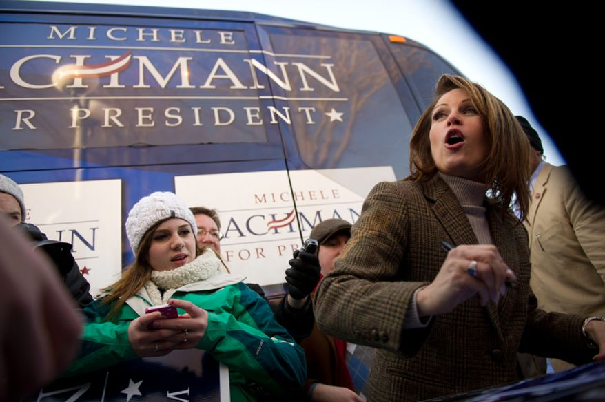 Republican presidential candidate Michele Bachmann signs campaign signs for Juniors and seniors from Taylor High School in Cincinnati, Ohio after visiting Paula's Maid Rite Restaurant on a campaign stop, West Des Moines, IA, Monday, January 2, 2012. (Andrew Harnik / The Washington Times)