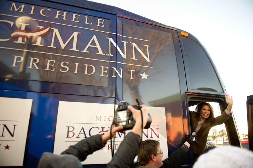 Republican presidential candidate Michele Bachmann waves goodbye from her campaign bus after visiting Paula's Maid Rite Restaurant on a campaign stop, West Des Moines, IA, Monday, January 2, 2012. (Andrew Harnik / The Washington Times)
