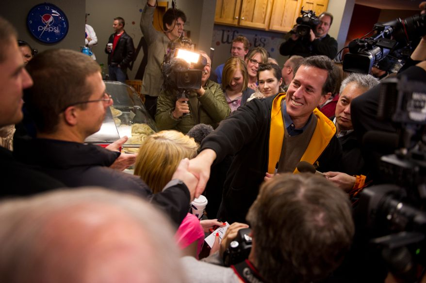 Republican presidential candidate Rick Santorum greets Iowans after delivering a speech at a campaign stop at The Reising Sun Cafe. (Andrew Harnik / The Washington Times)