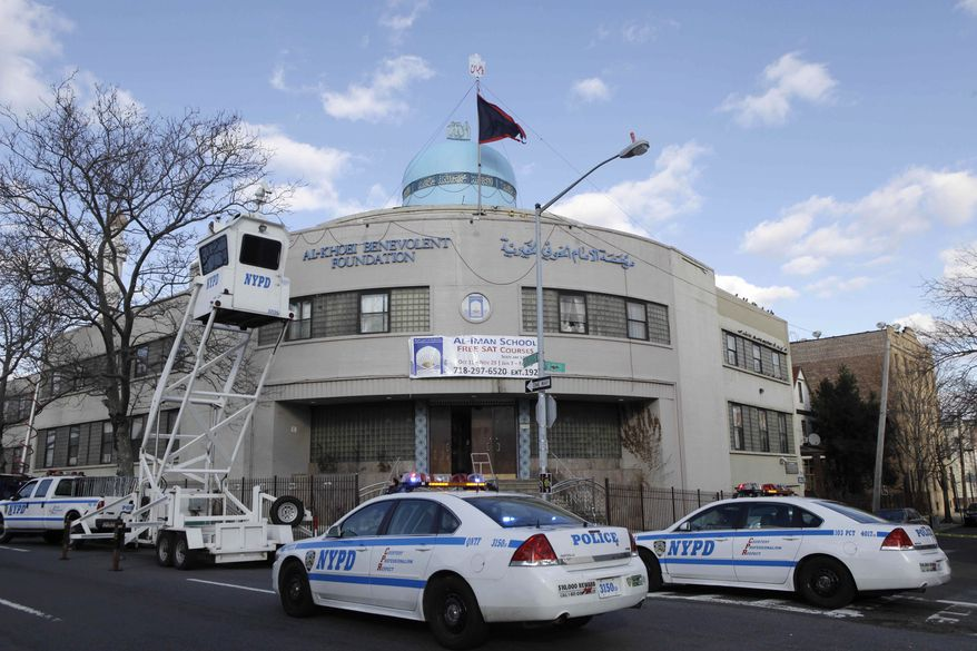 Police test an overhead surveillance lift in front of the Iman al-Khoei Benevolent Foundation in New York on Jan. 2, 2012. The foundation houses an Islamic cultural center, including a school, that was attacked by an unknown assailant who hurled a Molotov cocktail at the front of the building as members gathered for dinner. (Associated Press)