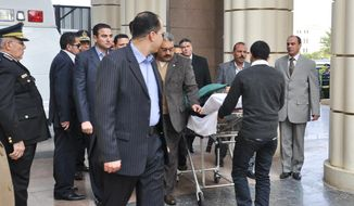 Former Egyptian president Hosni Mubarak is wheeled on a gurney Jan. 2, 2012, as he arrives at a courthouse in Cairo. (Associated Press)