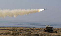 A Ghader missile is launched Jan. 2, 2012, at the shore of sea of Oman during Iran's navy drill. Iran test-fired a surface-to-surface cruise missile during a drill that the country's navy chief said proved Tehran was in complete control of the strategic Strait of Hormuz, the passageway for one-sixth of the world's oil supply. (Associated Press/Fars News Agency)