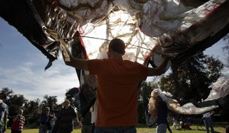 Occupy activists test a giant octopus made with plastic bags Dec. 29, 2011, in Pasadena, Calif. Activists with the Occupy movement, which protests perceived corporate greed and growing economic inequality, are planning to turn out en masse, on Jan. 2, at the annual Rose Parade accompanied by their own floats of sorts. (Associated Press)