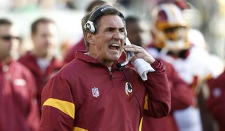 Washington Redskins head coach Mike Shanahan reacts during the first half of an NFL game against the Philadelphia Eagles, Sunday, Jan. 1, 2012, in Philadelphia. (AP Photo/Mel Evans)