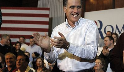 Republican presidential candidate and former Massachusetts Gov. Mitt Romney arrives Jan. 1, 2012, for a campaign appearance at the Bayliss Park Hall in Council Bluffs, Iowa. (Associated Press)