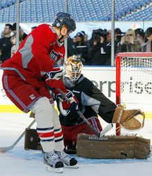 New York Rangers' Marc Staal (left) shoots on goalie Martin Biron during practice Jan. 1, 2012, the day before the Rangers play the Philadelphia Flyers in the NHL's Winter Classic in Philadelphia. (Associated Press)