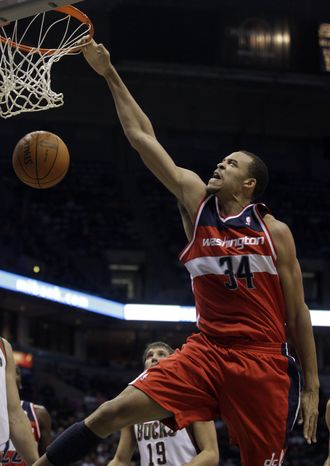 Washington Wizards' JaVale McGee dunks during the first half of an NBA basketball game against the Milwaukee Bucks Friday, Dec. 30, 2011, in Milwaukee. (AP Photo/Morry Gash)