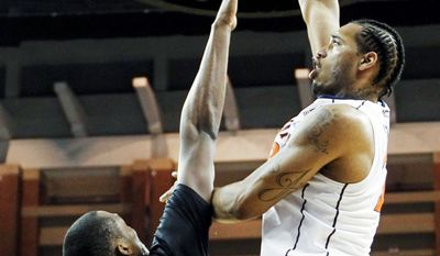 Robert Nwankwo (left) and Towson came close at Virginia on Friday, but the Tigers fell 57-50. It was their 13th of 14 losses this season. (Associated Press)