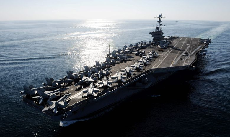 U.S. Navy via Associated Press The Nimitz-class aircraft carrier USS John C. Stennis transits the Strait of Hormuz on Nov. 12. The Pentagon declared Tuesday that U.S. warships will continue regularly scheduled deployments to the strategic waterway, despite warnings against doing so from Iran.