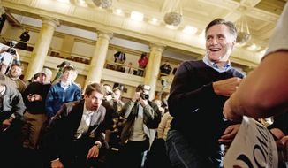 Republican presidential candidate Mitt Romney holds an early morning rally at the Temple for Performing Arts on the day of the Iowa caucus, Des Moines, IA, Tuesday, January 3, 2012. (Andrew Harnik/The Washington Times)
