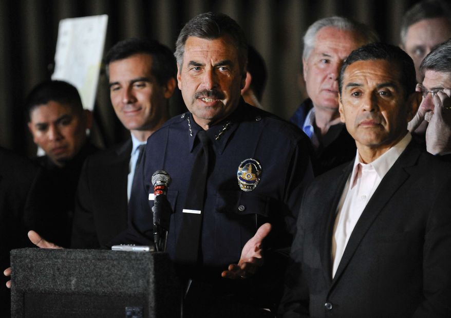 Los Angeles Police Department Chief Charles Beck flanked by Los Angeles Mayor Antonio Villaraigosa, right, answers questions during a news conference of the joint task force announcing the apprehension of a prime suspect Harry Burkhart in a series of 53 blazes in the Los Angeles Area, Monday, Jan. 2, 2012. (AP Photo/Gus Ruelas)