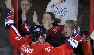 Washington Capitals left wing Troy Brouwer celebrates his goal with the fans behind the glass during the second period of an NHL game against the Calgary Flames, Tuesday, Jan. 3, 2012, in Washington. (AP Photo/Nick Wass)