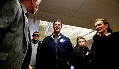 Republican presidential candidate Rick Santorum arrives to speak at Rock The Caucus assembly held at Valley High School on the day of the Iowa caucus, West Des Moines, IA, Tuesday, January 3, 2012. (Andrew Harnik / The Washington Times)