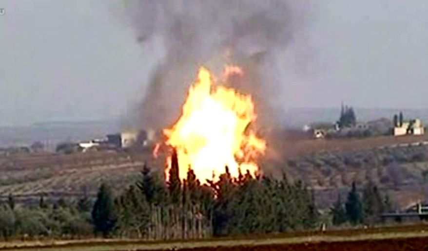 Flames raise from a gas pipeline after an explosion near the town Rastan in the restive Homs province of Syria on Jan. 3, 2012. The Syrian government blamed the explosion on terrorists, according to the Syrian official news agency SANA. (Associated Press/SANA)